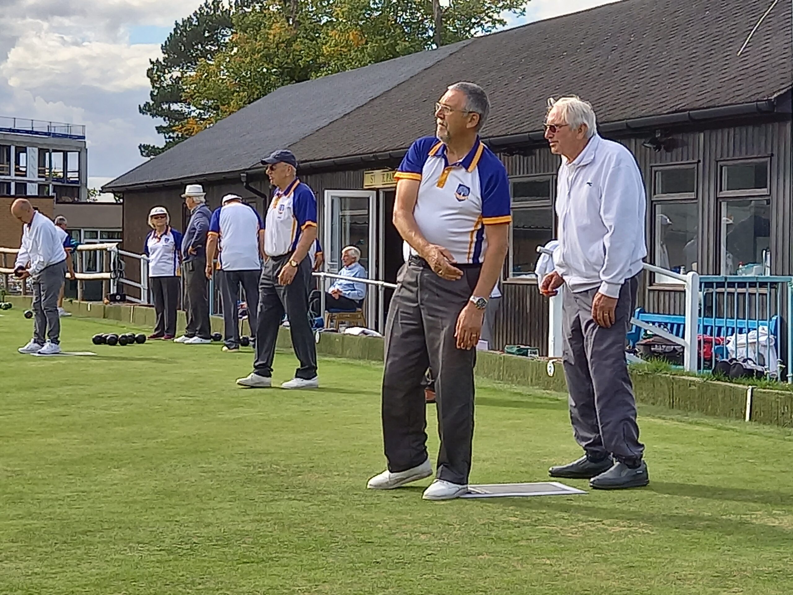 people playing bowls outside